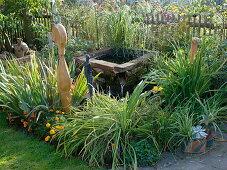 Art garden, water basin and perennials