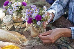 Jars with corn leaves dressed as vases