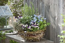 Homemade wicker basket with goat willow, willow and grass