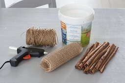 Dress yoghurt pails as a pot with cinnamon sticks