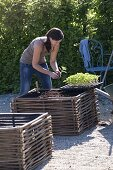 Gravel terrassse with raised beds made of hazelnut rods