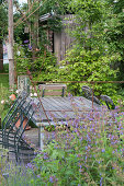 Seating on wooden deck in the natural garden