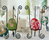 Colored eggs with various leaf patterns in wire frames