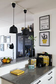 Black and yellow accessories on kitchen counter