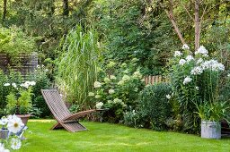 Flowerbeds and lawn in idyllic garden