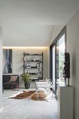 Cowhide rug in modern living room in shades of grey and black