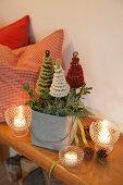 Candle lanterns around arrangement of crocheted fir trees