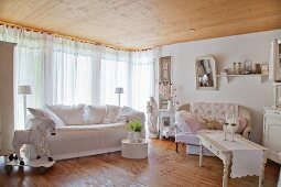 Two sofas and wooden horse in shabby-chic living room