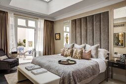 Glamorous bedroom in pastel shades with access to terrace