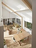 View down into open-plan living room in natural shades