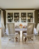 Rattan chairs around set dining table