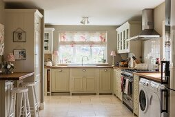 Pale country-house kitchen