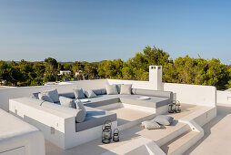 Masonry seating area on Mediterranean roof terrace