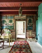 Desk, murals and kilim rug in study