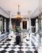 Mirrored pillars, grand doorway, round glass table and classic designer pieces