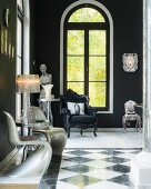 Chequered marble floor and white Panton S chairs