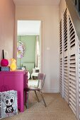 Hot pink desk and under-stair cupboard in hall