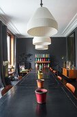 Vintage tables and dark walls in dining room
