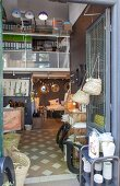 View into shop with patterned floor selling vintage items