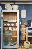Open cupboard in shop selling vintage items and accessories