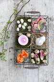 Easter arrangement in decorative wire basket