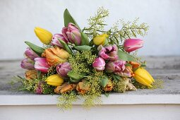 Luxuriant bouquet of tulips and delicate touch-me-not