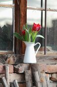 Red tulips in vintage jug