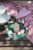 Wreath of carnations around candle