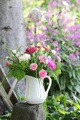 Posies of carnations in jug