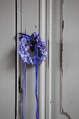 Small wreath of hyacinth florets with blue ribbon