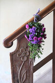 Posy of asters on banister