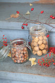 Walnuts and hazelnuts in mason jars