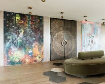 Hand-crafted double doors between large modern artworks