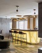 Circular lamps above lit bar area