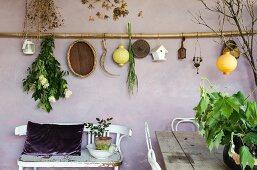 Mediterranean decorations hung on lilac wall on Mediterranean loggia
