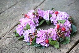Luxuriant wreath of hydrangeas, berries and leaves