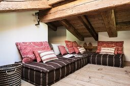 Floor couch with scatter cushions in attic living room