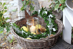 Candle lantern, box arrangement, quinces and sweet chestnuts in basket