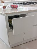 Open drawer in tapering island counter