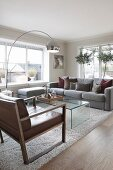 Arc lamp and grey couch in elegant lounge area