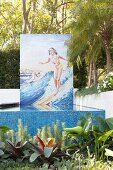 1950s mosaic with surfer over the pool in the garden