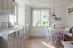 Country-house-style kitchen-dining room flooded with light
