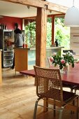 Island counter and exposed beams in open-plan kitchen