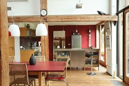 Rustic beams in open-plan kitchen