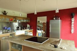 Island counter and red wall in kitchen