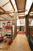 Gallery in modernised, converted barn with rustic half-timbered structure
