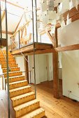 Modern wooden staircase in renovated period building with half-timbered structure