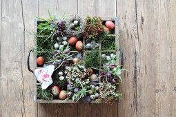 Easter flower arrangement in vintage bottle crate