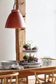 Festive Easter flower arrangement on cake stand on wooden table