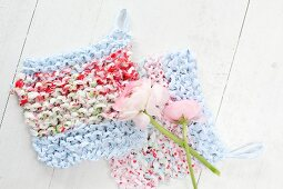 Ranunculus on crocheted rag-yarn dishcloths